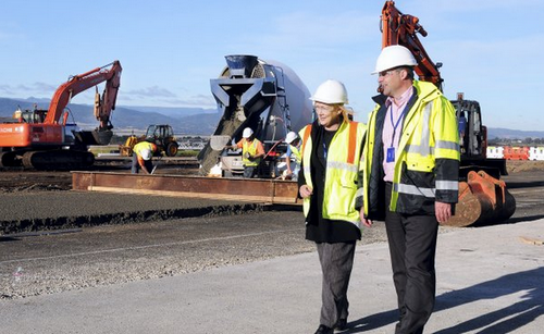 Launceston Airport general manager Pamela Graham and project manager Ray Brown inspect progress on the apron. Image & caption from The Examiner.